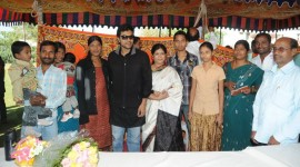 Ram Charan Teja Distributes Clothes to Poor People