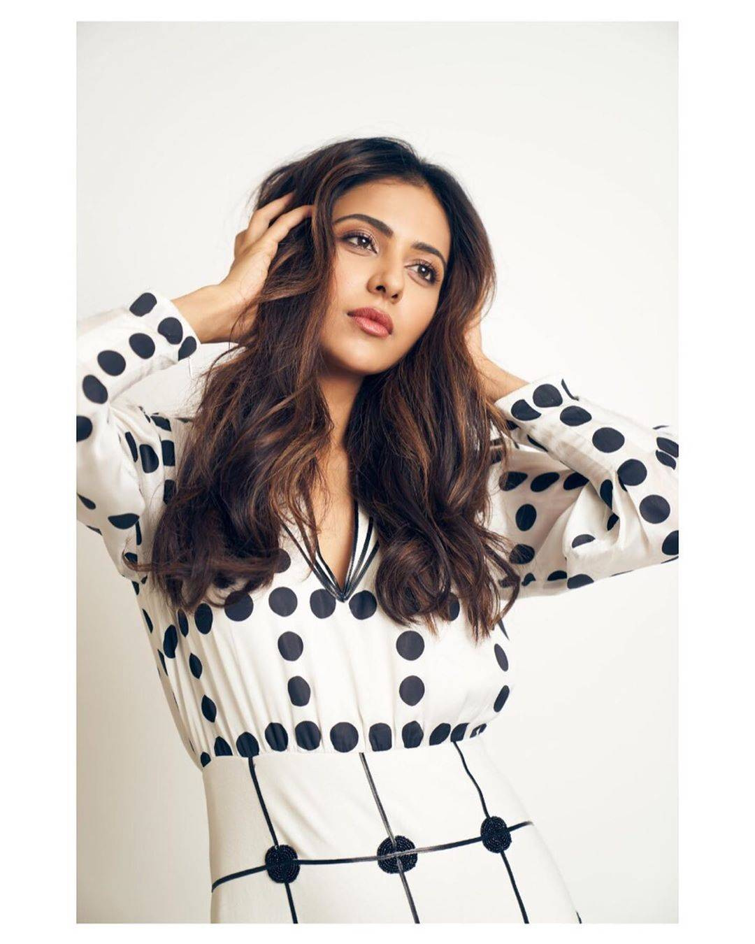 We'd have gone for a high pony and oversized shades for this outfit, but make-up artist Chakravarthi Kadali and Hairstylist Tina Mukharjee kept it very mainstream with a simple-face look and teased out voluminous hair. - Fashion Models