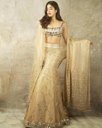 The embroidery work on the mermaid-cut skirt of the lehenga is matched by work on the shawl - Fashion Models
