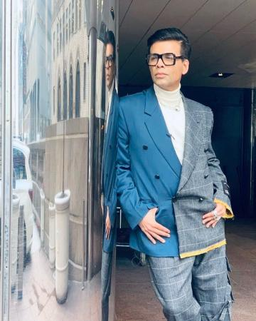 Karan Johar, is getting the rest of the world to agree that he is dapper, appearing at the Emmy Awards in this suit from the fall collection of Vetements - Fashion Models