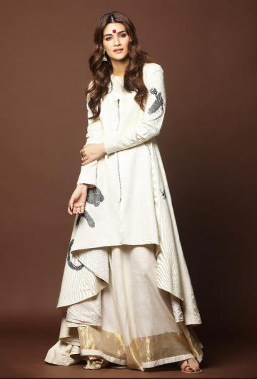 The white printed asymmetrical angraka kurta matches beautifully with the flowy gold zari skirt - Fashion Models