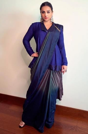 We love the effect of the long pleated blouse and the multi-coloured print of the saree - Fashion Models