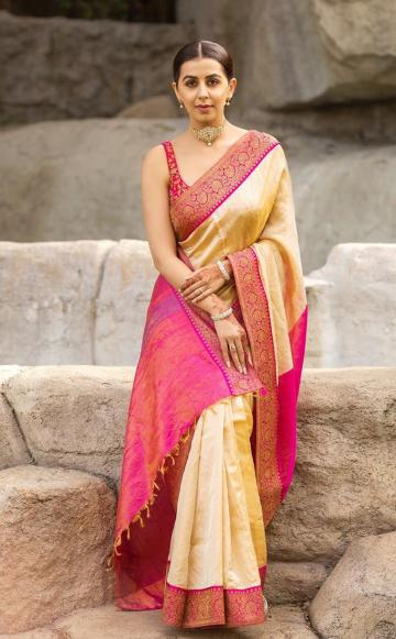 The intricately embroidered borders look great on the dull gold setting and the becoming shade of pink suits her - Fashion Models
