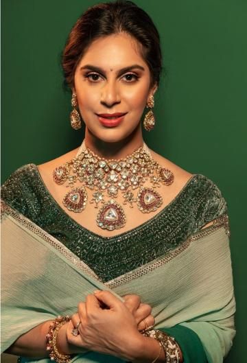 The huge earrings and matching heavy choker from Birdi Chand defines the look - Fashion Models