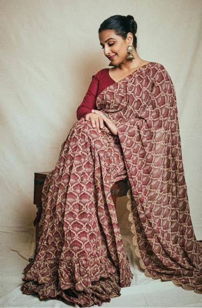 The leaf motif print saree has a frilly border and paired well with a solid maroon blouse - Fashion Models