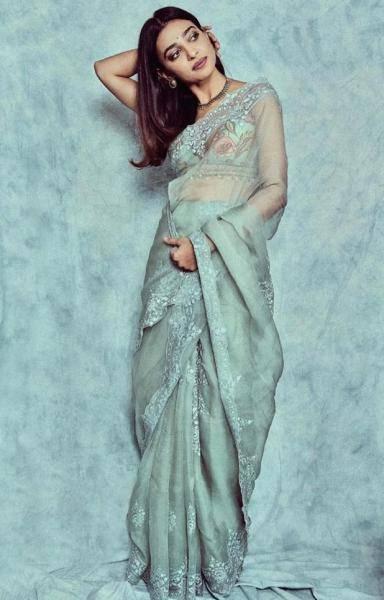 The sheer organza saree has a cute embroidered border and beautiful aari waraq work - Fashion Models