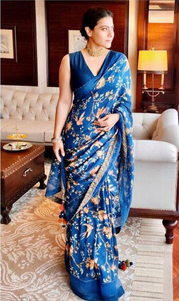 We love the plain V-neck blouse and the floral riot that is the saree - Fashion Models