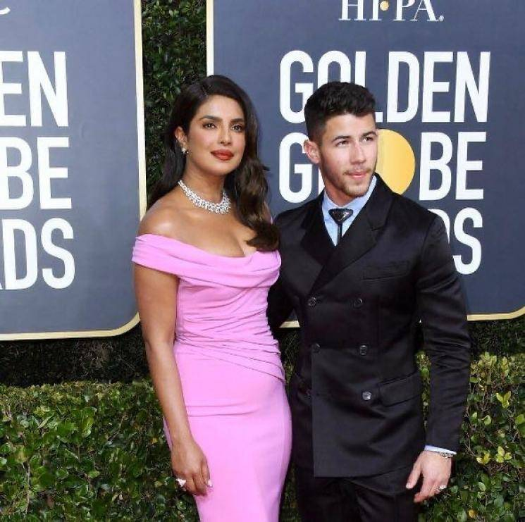 Priyanka Chopra arrived for the 77th Annual Golden Globe Awards with her husband Nick Jonas looking sexy in this bubblegum pink gown from Cristina Ottaviano - Fashion Models