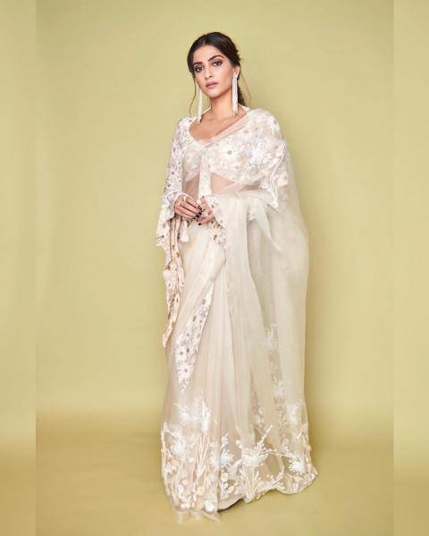 Sheer white suits Sonam well, and she pulls off the drama of the earrings well too - Fashion Models
