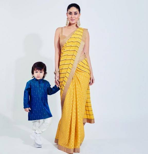 Little mister internet-breaker is wearing a cute blue kurta that designer Raghavendra Rathore made just for him - Fashion Models