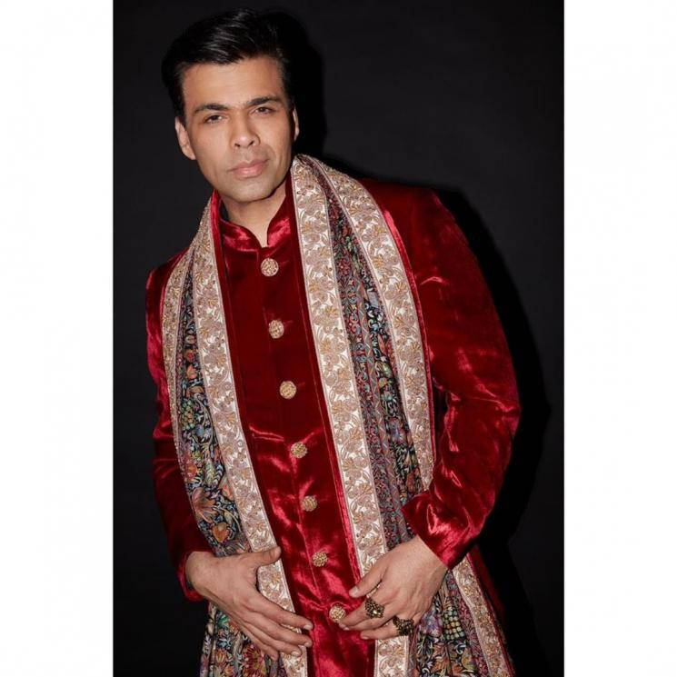 Karan Johar is the one man who can get away with a shiny red kurta, and he recently did so with elan - Fashion Models