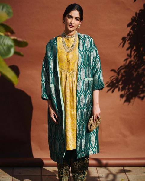 The mustard yellow kurta with a V-shaped waistline looks great with the oversized, bling coat  - Fashion Models