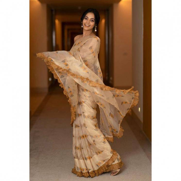 The brown ruffles on this semi transparent light saree look fabulous  - Fashion Models