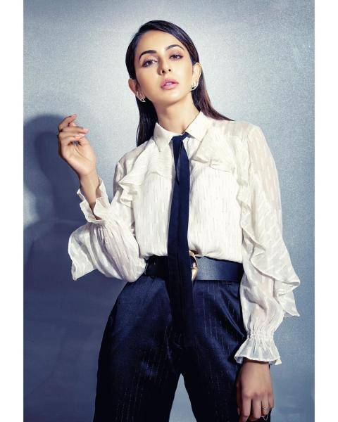 The white sheer shirt has an interesting sleeve and the crop trousers and tie look great - Fashion Models