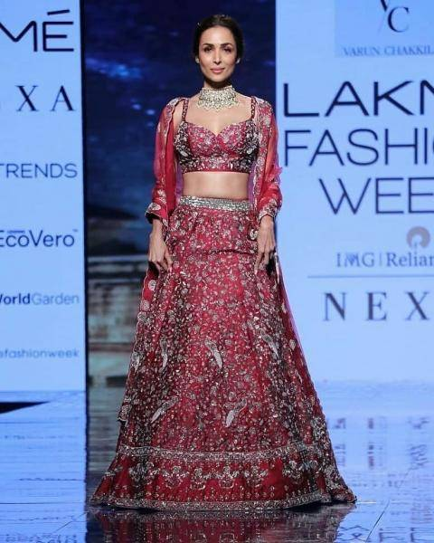 The lehenga is a wondrous collage of embroidery work mostly based on folaige, with cute parrots all over the skirt - Fashion Models