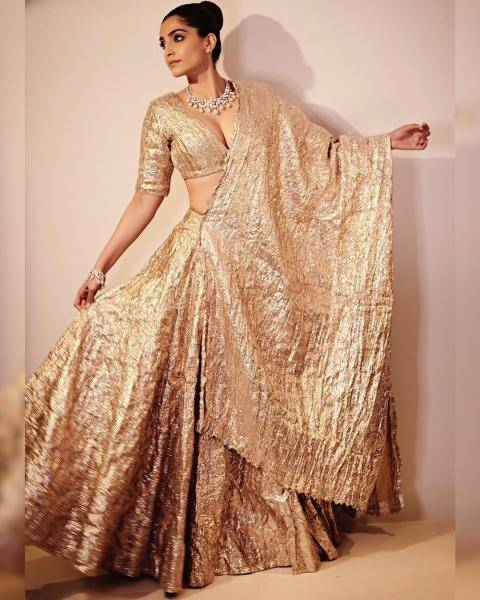 The crumpled material in gold is a wonderful option and the daring top makes the attire pretty stunning - Fashion Models