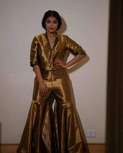 Reema Kallingal was seen at the Vanitha awards in this shimmery golden outfit from Raw Mango   - Fashion Models