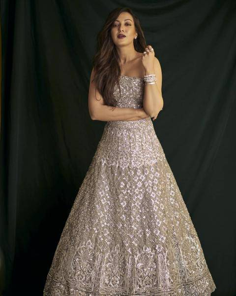 The grey-silver lehenga with traditional embroidery is paired with a one-shoulder blouse which is equally glittery - Fashion Models