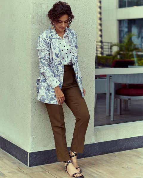 The cool coat with ink coloured print is a cool number and pairs well with the tan trousers and the polka shirt underneath - Fashion Models