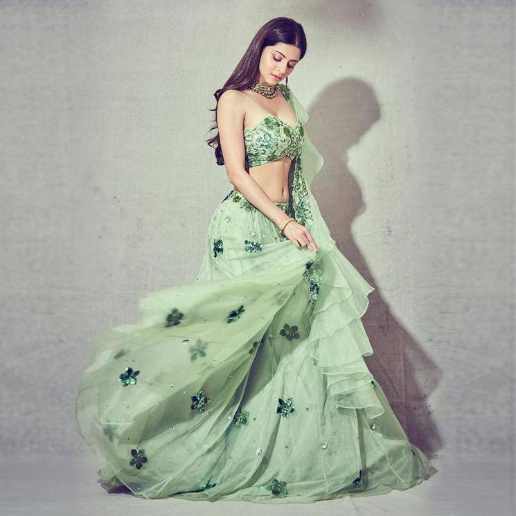 The spring green organza lehenga with floral designs is paired with a matching noodle strap top  - Fashion Models