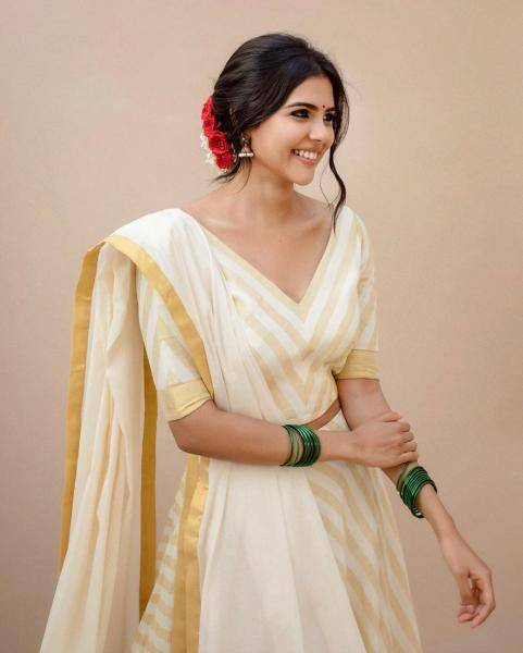 The girl has rounded the look off with glass bangles, flowers in the hair and beautiful jimikki earrings - Fashion Models