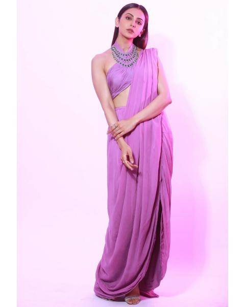 The outfit, reminiscent of a quirkily draped saree, has a halter top, an ascetic skirt and a pallu-like drape on the left shoulder - Fashion Models