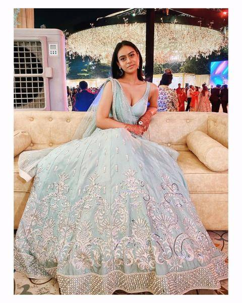 The pastel lehenga has a full bell skirt and extravagant embroidery - Fashion Models